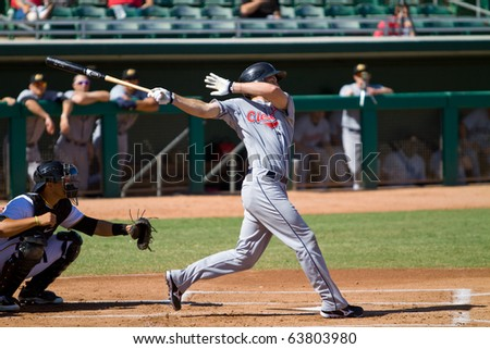 MESA, AZ - OCTOBER 18: Cord Phelps, a top prospect for the Cleveland Indians, bats for the Peoria Javelinas in an Arizona Fall League game Oct. 18, 2010 at HoHoKam Stadium. Peoria beat Mesa, 4-2. - stock photo