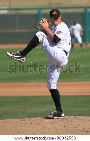 MESA, AZ - OCTOBER 26: Gerrit Cole, the Pittsburgh Pirates' first-round draft pick in 2011, pitches for the Mesa Solar Sox in the Arizona Fall League Oct. 26, 2011 at HoHoKam Stadium, Mesa, AZ. - stock photo