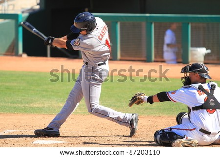MESA, AZ - OCTOBER 17: Jason Castro, a catcher in the Houston Astros farm system, bats in an Arizona Fall League game Oct. 17, 2011 at HoHoKam Stadium. Castro went 0-for-3 but threw out a base runner. - stock photo
