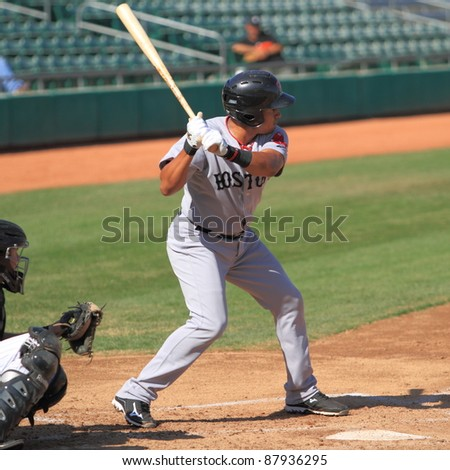 MESA, AZ - OCTOBER 26: Ryan Dent, a Boston Red Sox prospect, bats for the Scottsdale Scorpions in the Arizona Fall League Oct. 26, 2011 at HoHoKam Stadium, Mesa AZ. Dent doubled twice and walked. - stock photo