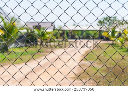 Mesh Fence with Blurred Background.