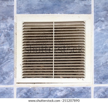 mesh grille in the wall ventilation - stock photo