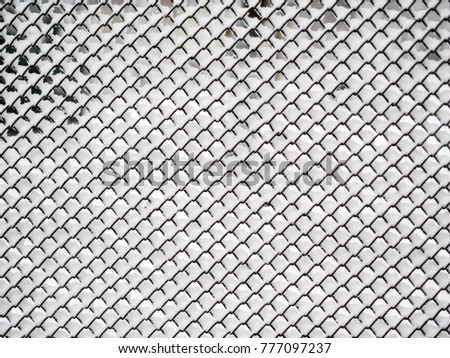 Mesh-netting covered with white fresh snow After A Heavy Blizzard