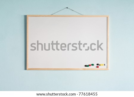 Message board hanging on a blue wall. - stock photo