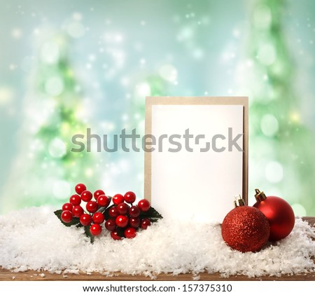 Message card with red ornaments over Christmas tree background - stock photo