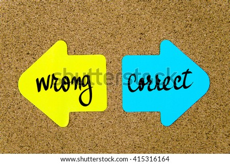 Message Correct versus Wrong on yellow and blue paper notes as opposite arrows pinned on cork board with thumbtacks. Choice conceptual image - stock photo