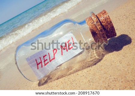 "Message in a bottle ""Help me"". Creative help and support concept"