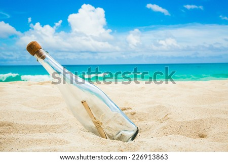Message in a bottle on a shore