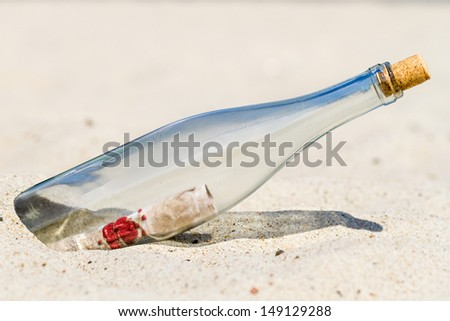 Message in a bottle on the beach - stock photo