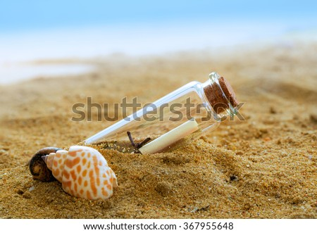Message in a Bottle on the san, bottle with a message - stock photo