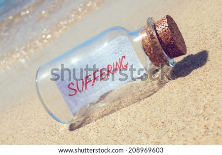 "Message in a bottle ""Suffering"". Help and support concept"