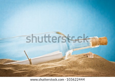 message in bottle on sand - stock photo