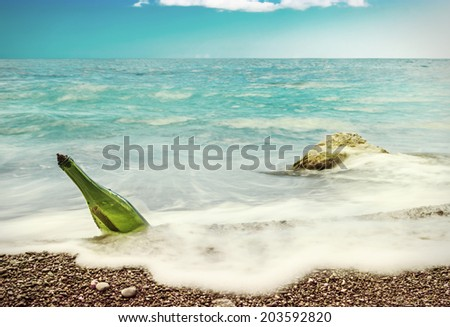 Message in bottle on sea-beach background. toning style instagram - stock photo