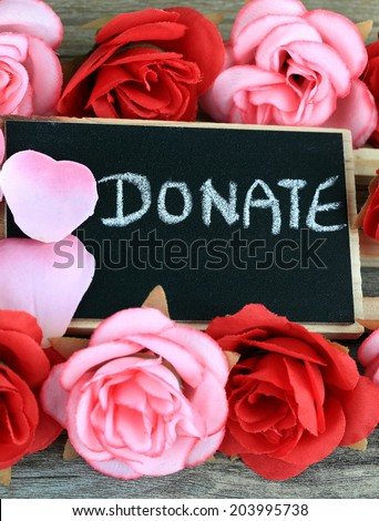 message of donation, with flowers in the background