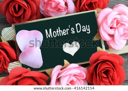 """message of """"mother's day"""" with heart and flowers - stock photo"""