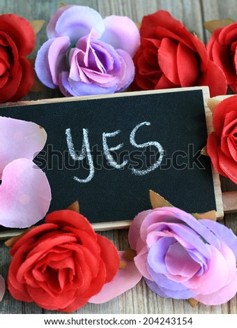 message of yes with flowers in the background