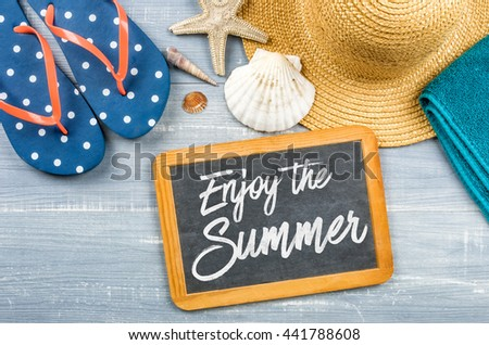 Message on a chalkboard - Enjoy the Summer - stock photo
