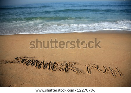 """Message says """"summer fun""""   in the Sand on a Beach with waves and blue ocean concepts - stock photo"""