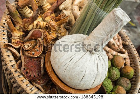 message with a bag of heated medicinal herbs - stock photo