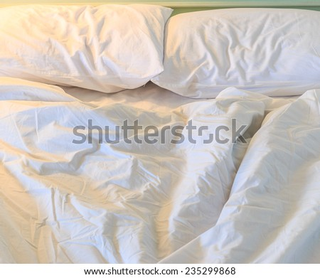 Messy and unmade bed  - stock photo