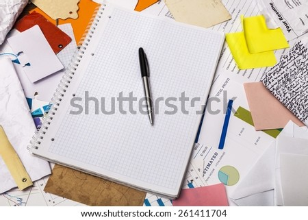 Messy desk - stock photo