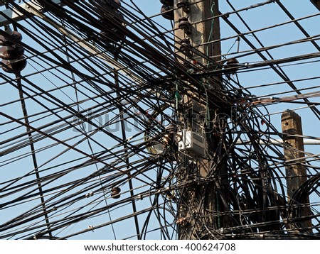Messy electrical cables and wires on electric pole    - stock photo