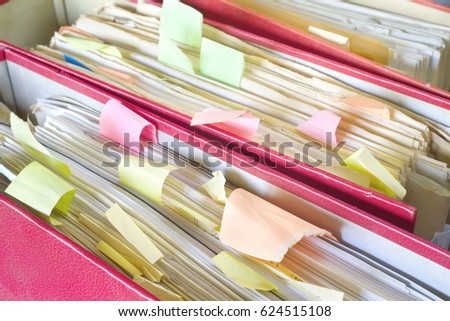 messy file folders and documents,close up, selective focus