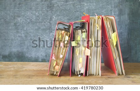 messy file folders and documents,free copy space  - stock photo