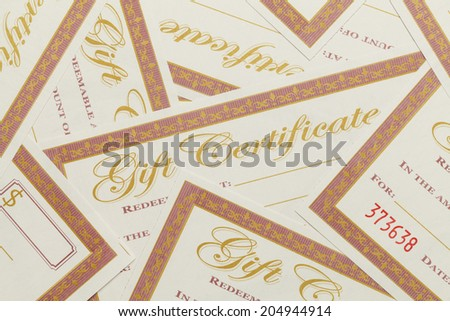 Messy Pile of Blank Gift Certificates Background. - stock photo