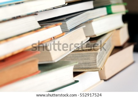 Messy pile of books. Selective focus, low aperture shot