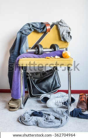 messy room lifestyle teenager sports clothes laundry - stock photo