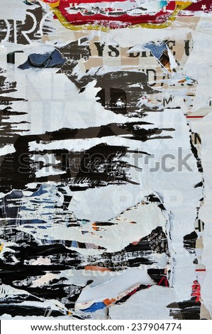 Messy torn paper ripped posters abstract weathered background texture.