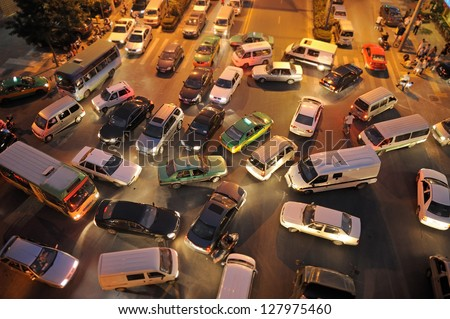 Messy traffic at crossroad in China. Night Time, aerial view - stock photo