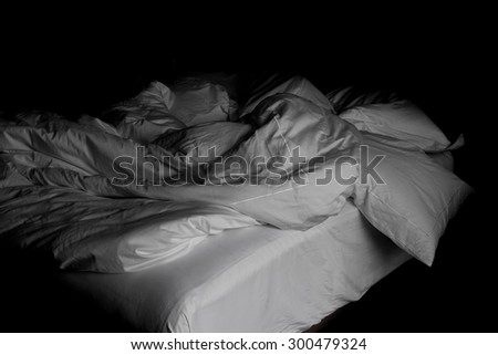 Messy white bed and pillow, in the morning - stock photo