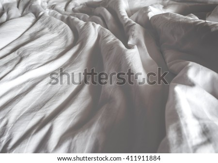 Messy white bed and two pillow, in the morning.Vintage filter. - stock photo