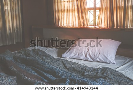 Messy white bed.Vintage filter. - stock photo