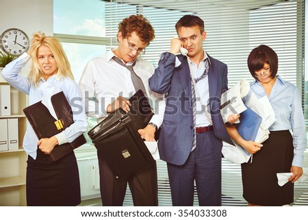 Messy white collar workers being confused after briefing - stock photo