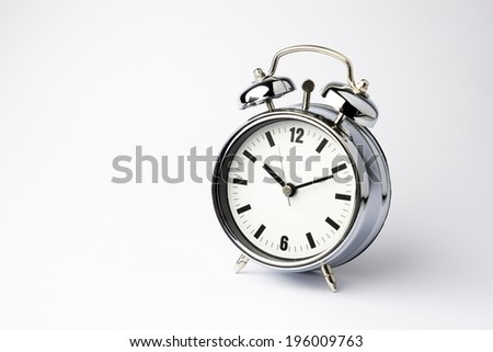 Metal Alarm clock on isolate white background