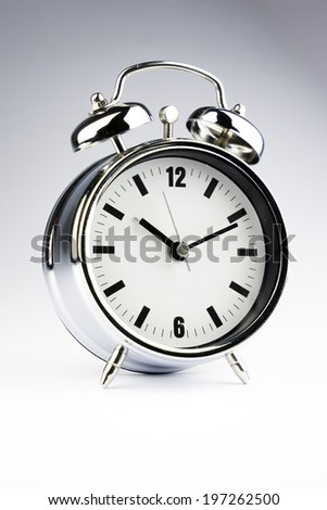 Metal Alarm clock on isolate white background - stock photo