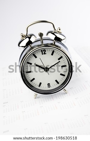 Metal Alarm clock work time on white background 10 am.  - stock photo