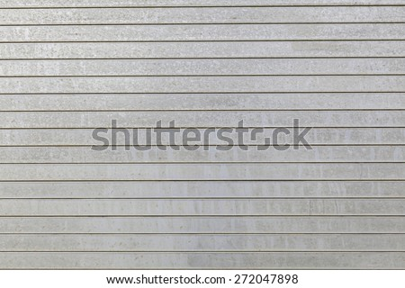 Metal aluminum siding wall horizontal stripes aged rust spots - stock photo