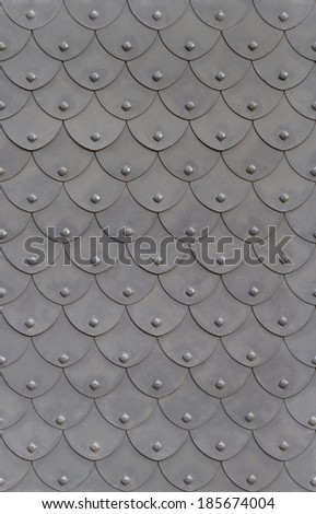 metal armor fish scale with rivets seamless background - stock photo