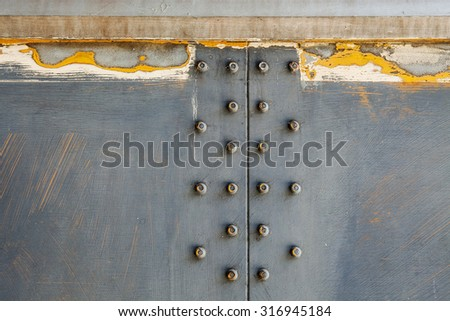 Metal background. Grunge background metal plate with screws - stock photo