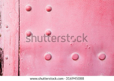 Metal background of old steam pink locomotive. Grunge background metal plate with screws - stock photo