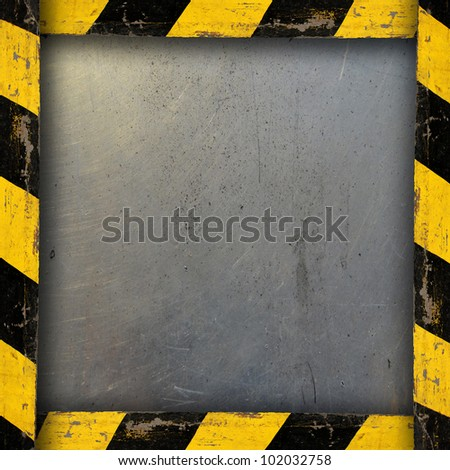 Metal Background With Belt Warning. Plate with safety straps. - stock photo