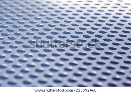 Metal background with holes - stock photo