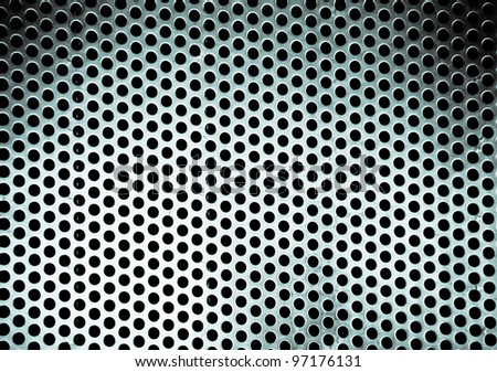Metal background with round hole and reflection. Close up
