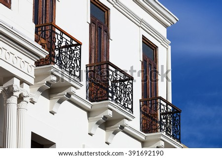 metal balconies on a white building