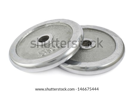 Metal barbell 5 kilogram plates one over another isolated against white background