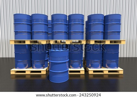 Metal barrels of fuel on a wooden pallet in the industrial warehouse. - stock photo